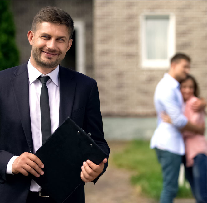 Real estate property agent dressed in suit and tie
